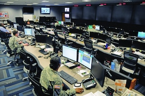 Uniformed and civilian cyber and military intelligence specialists monitor Army networks in the Cyber Mission Unit's Cyber Operations Center at Fort Gordon, Ga. U.S. Army photo by Michael L. Lewis