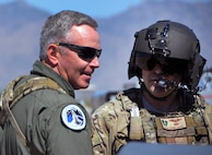 U.S. Air Force Major Gen. William Binger, left, talks to Staff Sgt. Shawn McBee, a 305th Rescue Squadron special mission aviator, on the flight line at Davis-Monthan Air Force Base, Ariz., March 9. Binger visited the 943rd Rescue Group to see its combat search and rescue mission firsthand. He is the Mobilization Assistant to the Deputy Chief of Staff for Operations, Headquarters U.S. Air Force, Washington, D.C. (U.S. Air Force photo by Carolyn Herrick)
