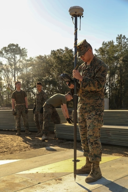 A U.S. Marine with Marine Wing Support Squadron 272 measures elevation levels AM-2 aluminum matting during a Marine Corps Combat Readiness Evaluation at Marine Corps Auxiliary Landing Field Bogue, N.C., March 17, 2016. The MCCRE, which went from March 14-18, tested MWSS-272's ability to build an AM-2 aluminum matting V/TOL pad ready to accept incoming aircraft. MWSS-272 is part of Marine Aircraft Group 26, 2nd Marine Aircraft Wing. (U.S. Marine Corps photo by Cpl. Kaitlyn V. Klein/Released)