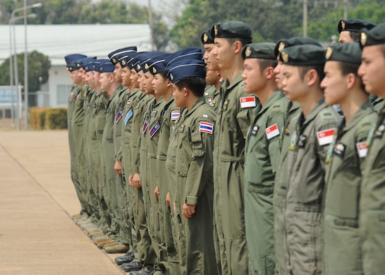Pilots from the Republic of Singapore Air Force, the Royal Thai Air Force, and the U.S. Air Force stand in formation during the closing ceremony of Exercise Cope Tiger 16 on Korat Royal Thai Air Force Base, Thailand, March 18, 2016. The multilateral exercise involved a combined total of 87 aircraft that completed 1,003 sorts of a two week period. Exercise Cope Tiger 16 included over 1,200 personnel from three countries and continues the growth of strong, interoperable and beneficial relationships within the Asia-Pacific Region, while demonstrating U.S. capability to project forces strategically in a combined, joint environment. (U.S. Air Force Photo by Tech Sgt. Aaron Oelrich/Released)