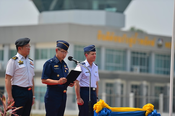 Republic of Singapore Air Force Brig. Gen. Hoo Cher Mou, chief of air force, Royal Thai Air Force Air Chief Marshal Treetod Sonjance, RTAF commander-in-chief, and U.S. Air Force Maj. Gen. Micheal Compton, Air National Guard assistant to the commander at Pacific Air Forces from Joint Base Pearl Harbor-Hickam, Hawaii, co-officiate the closing ceremony of Exercise Cope Tiger 16 on Korat Royal Thai Air Force Base, Thailand, March 18, 2016. Cope Tiger, which is in its 22nd year, is an annual multilateral aerial exercise supporting regional peace and security by improving readiness and multi-national interoperability between the Republic of Singapore Air Force, Royal Thai Air Force, and U.S. Air Force. (U.S. Air Force Photo by Tech Sgt. Aaron Oelrich/Released)
