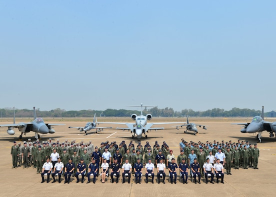 Military members from the Republic of Singapore Air Force, Royal Thai Air Force and U.S. Air Force mark the conclusion of Exercise Cope Tiger 16 on Korat Royal Thai Air Force Base, Thailand, March 18, 2016. The multilateral exercise involved over 1,200 personnel from three countries and a combined total of 87 aircraft that completed 1,003 sorts over two weeks. In addition, trilateral civic assistance programs conducted during Cope Tiger 16 helped to promote good relationships between the three countries' forces and Thai communities near Korat Royal Thai Air Force Base. I Cope Tiger, which is in its 22nd year, is an annual multilateral aerial exercise supporting regional peace and security by improving readiness and multinational interoperability between the Republic of Singapore Air Force, Royal Thai Air Force, and U.S. Air Force. (U.S. Air Force Photo by Tech Sgt. Aaron Oelrich/Released)