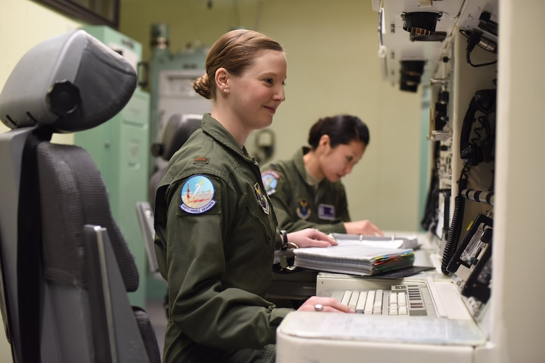 Second Lt. Alexandra Rea, the 490th Missile Squadron combat crew deputy director, left, and 1st Lt. Elizabeth Guidara, the 12th Missile Squadron combat crew deputy director, perform training at the Malmstrom Air Force Base, Mont., missile procedures trainer March 21, 2016. In honor of Women's History Month, 90 female missileers based out of Minot Air Force Base, N.D., F.E. Warren AFB, Wyo., and Malmstrom AFB completed a 24-hour alert. In addition, B-52 Stratofortress aircrews from Minot AFB and Barksdale AFB, La., participated by fielding all-female flight crews. (U.S. Air Force photo/Airman Collin Schmidt)