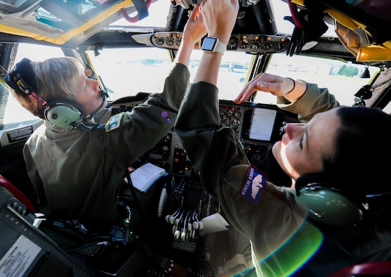 Col. Kristin Goodwin, the 2nd Bomb Wing commander, and Maj. Heather Decker, a 93rd Bomb Squadron instructor pilot, go through their preflight checklist prior to takeoff at Barksdale Air Force Base, La., March 22, 2016. (U.S. Air Force photo/2nd LT. Jessica Adams)