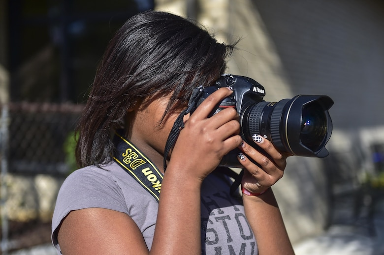 Zayiah Craig, 11, takes photos of nature at the Hurlburt Field Youth Center, March 14, 2016. Craig's passion for photography began two years ago when she took photos during a family vacation. (U.S. Air Force photo by Senior Airman Jeff Parkinson)