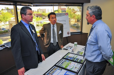 The Los Angeles District's Kim Gavigan (left), chief of the water resources planning section and Ed Demesa, chief of the planning division, speak with a contractor at the Arizona-Nevada Area Office's Business Opportunities Open House March 17. The event featured morning and afternoon sessions with two training opportunities; successful proposal preparation, and job site safety.