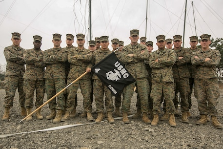 Marines from 4th Marine Regiment's Communication Platoon pose with their unit flag, March 16, 2016, aboard Camp Mujuk, Republic of Korea. Communications Platoon, Headquarters Company, 4th Marine Regiment, 3rd Marine Division received the Lt. Col. Kevin M. Shea Memorial Unit of the Year Award. The award recognizes the communications or information technology unit that made the most significant contributions to the Marine Corps command, control, communications and computer field. 4th Marine Regiment is currently supporting III Marine Expeditionary Force during Exercise Ssang Yong 2016.
