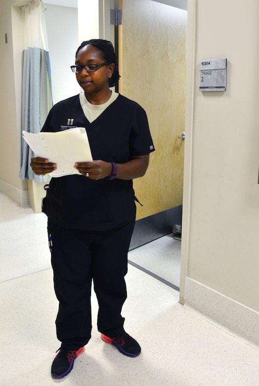 U.S. Air Force Capt. Michella Mayo-Smith, an emergency services clinical nurse from the 633rd Medical Operations Squadron, calls a patient to be triaged in the USAF Hospital Langley Emergency Room at Langley Air Force Base, Va., Feb. 26, 2016. All of the nurses and doctors assigned to the ER specialize in trauma. (U.S. Air Force photo by Staff Sgt. Aubrey White)