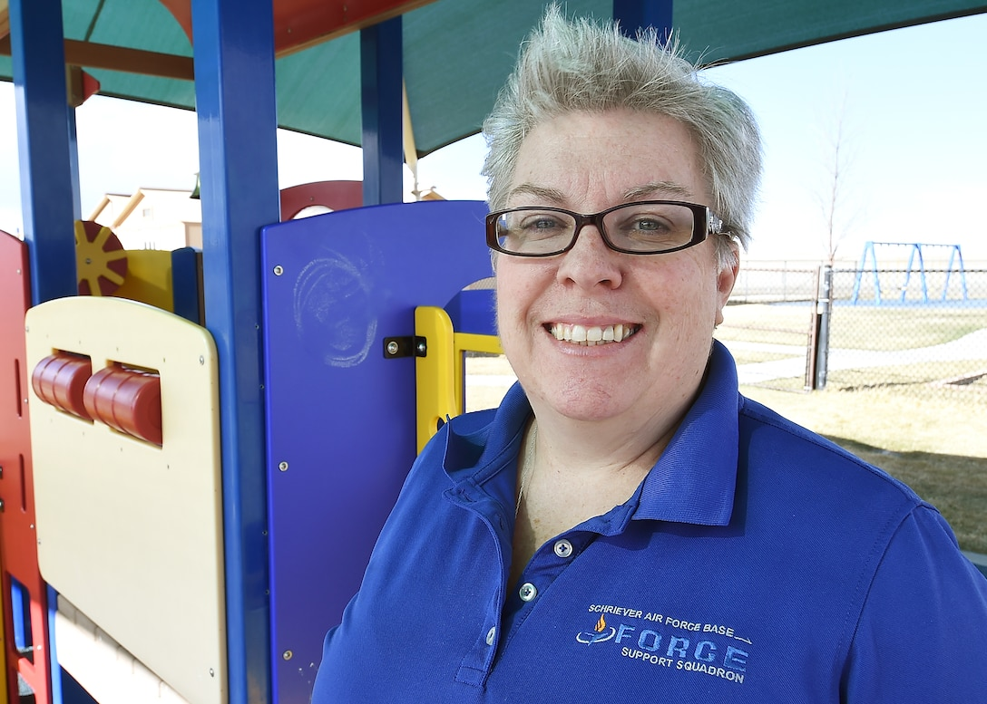 "Petula Buschert has worked at Schriever's Child Development Center since 2010 providing a safe and loving place for parents to leave their children as they complete the mission. Buschert looks forward to her hugs each day stating, ""The best part of my job is the children."" (U.S. Air Force photo/Staff Sgt. Debbie Lockhart)"