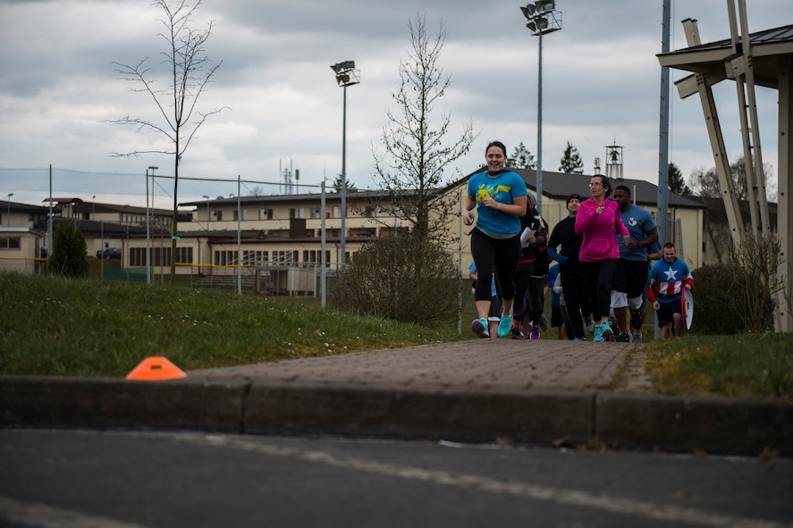 Participants follow cones on the ground during the Amazing Nutrition 5k Challenge at Spangdahlem Air Base, Germany, Mar. 22, 2016. The cones were set up to help participants follow the correct course that covered a wide area of the base. (U.S. Air Force photo by Senior Airman Luke Kitterman/Released)