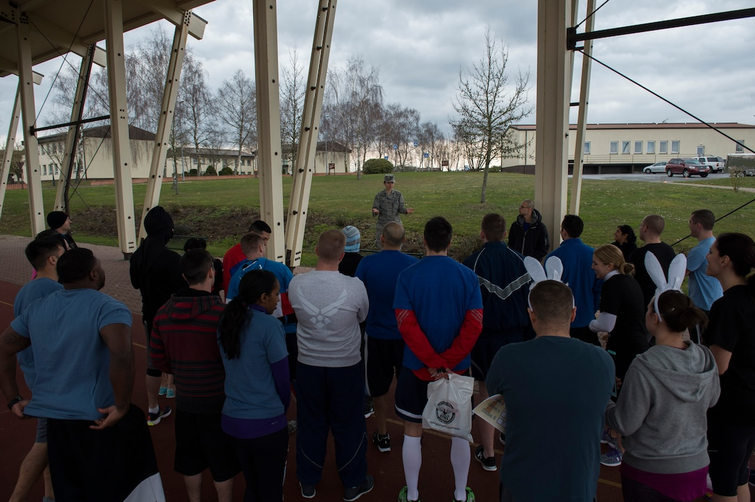 U.S. Air Force Capt. Denise Campbell, 52nd Aerospace Medicine Squadron health promotion dietitian, speaks to participants before the start of the Amazing Nutrition 5k Challenege at Spangdahlem Air Base, Germany, Mar. 22, 2016. More than 30 participants combined to make eight teams competing against one another. (U.S. Air Force photo by Senior Airman Luke Kitterman/Released)