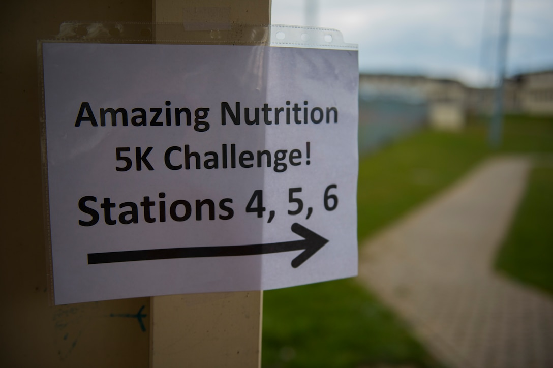 A sign directs participants to different stations during the Amazing Nutrition 5k Challenge at Spangdahlem Air Base, Germany, Mar. 22, 2016. The challenge consisted of six stations, each with a different task the participants needed to complete in order to proceed to the next one. (U.S. Air Force photo by Senior Airman Luke Kitterman/Released)