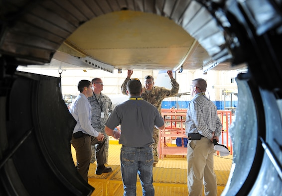 Lt. Gen. Bradley Heithold, Air Force Special Operations Command commander, takes a moment to talk with members of the C-130 AFSOC Acceleration Flight during his tour of the production lines at Robins Air Force Base. During the tour, Heithold was briefed on the programmed depot maintenance plan, lessons learned, the production gate flow process and the status of current aircraft on station. (U.S. Air Force photo by Tommie Horton)