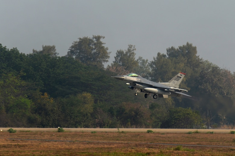 A U.S. Air Force F-16 Fighting Falcon takes off Feb. 15, 2016, at Korat Royal Thai Air Force Base, Thailand. Piloted by 1st Lt. Brittany Trimble, 36th Fighter Squadron pilot, this F-16 along with several other aircraft and pilots visited Thailand to participate in Cobra Gold 2016, a multinational exercise. This trip was Trimble's first experience flying in a multinational exercise. (U.S. Air Force photo by Staff Sgt. Amber E. N. Jacobs)