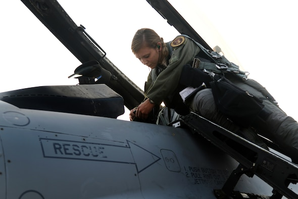 U.S. Air Force 1st Lt. Brittany Trimble, 36th Fighter Squadron pilot, plugs her air flight crew equipment into an F-16 Fighting Falcon before takeoff, Feb. 15, 2016, at Korat Royal Thai Air Force Base, Thailand. Women were first allowed to enter pilot training in 1976 and in 1993 women were finally authorized to enter fighter pilot training. Trimble is one of only 676 female pilots who serve in the U.S. Air Force. There are 12,823 pilots Air Force wide. (U.S. Air Force photo by Staff Sgt. Amber E. Jacobs)