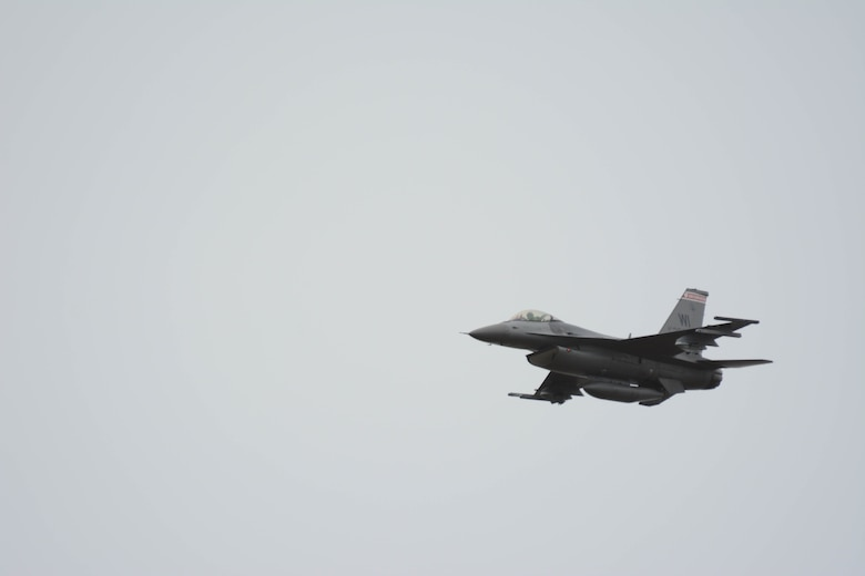 A 115th Fighter Wing F-16 Fighting Falcon flies over the Avon Park Air Force Range in Avon Park, Fla., during an air-to-ground combat competition Feb. 23, 2016. The jets were deployed to Homestead Air Reserve Base, Fla., to participate in the first competition between Total Force Integration Active Associate units. (U.S. Air National Guard photo by Staff Sgt. Andrea F. Rhode)