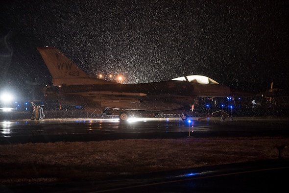 A U.S. Air Force F-16 Fighting Falcon idles in the snow as it waits to be armed during exercise Beverly Sunrise 16-03 at Misawa Air Base, Japan, March 22, 2016. The 35th Fighter Wing's collections of F-16s are multi-role fighter aircraft, capable of performing Suppression of Enemy Air Defenses tactics, and belong to the only SEAD wing in the Pacific Air Forces. (U.S. Air Force photo by Senior Airman Patrick S. Ciccarone/Released)