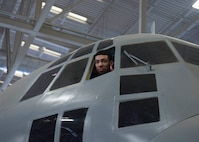 Danny Green, San Antonio Spurs shooting guard, looks out of a window of a training aircraft during a visit to the 37th Training Wing March 18 at Joint Base San Antonio-Lackland, Texas. Green visited the base as part of an NBA outreach program to show appreciation to members of the armed forces.