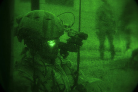 An Air Force joint terminal attack controller participates in a raid conducted by Maritime Raid Force, 31st Marine Expeditionary Unit, Dec. 14, 2015. The JTAC acted as the eyes on the ground for aircraft supporting the raid. The raid was part of Interoperability Exercise 16.1, an exercise used to build a working bond between MRF and the MEU quickly. (U.S. Marine Corps Photo by Cpl. Thor J. Larson/Released)