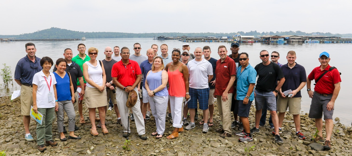"""160320-N-ZZ999-366 SINGAPORE (March 20, 2016) A group of 25 U.S. 7th Fleet Sailors, on a """"staff ride"""" during a port visit to Singapore, visit Seribum beach to learn more about the Battle of Singapore that took place during World War II.  Staff rides have been a part of military training for more than 100 years, and combine preliminary study of a selected campaign with an extensive visit to actual sites associated with that campaign. (U.S. Navy photo by Chief Mass Communication Specialist Hendrick Simoes/Released)"""