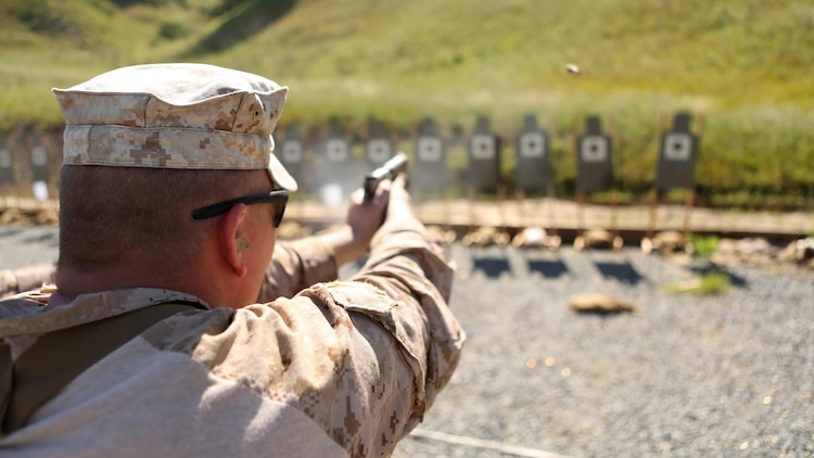 A Marine with Company A, 1st Reconnaissance Battalion performs a pistol drill during a combat marksmanship program led by Expeditionary Operations Training Group March 17, 2016 at Marine Corps Base Camp Pendleton, California. The shooting package helps to better prepare these Marines for an upcoming deployment with the 11th Marine Expeditionary Unit.