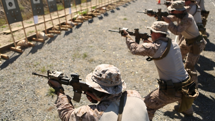 Marines with Company A, 1st Reconnaissance Battalion stand on line and perform rifle drills during a combat marksmanship program led by Expeditionary Operations Training Group March 17, 2016 at Marine Corps Base Camp Pendleton, California. The shooting package helps to better prepare these Marines for an upcoming deployment with the 11th Marine Expeditionary Unit.