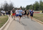 Walkers and runners leave the starting line at the McNamara Headquarters Complex Spring Fling 5K at Fort Belvoir, Virginia, March 20.