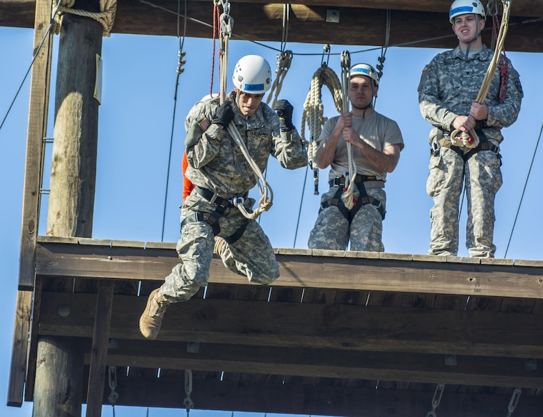Spc. Christopher L. Ubias, practical nursing specialist, 5502nd U.S. Army Hospital, of Denver, Colorado, rides a zip line to the ground during a team building exercise, March 8, 2016 at The Army Reserve Medical Command's 2016 Best Warrior competition at Fort Gordon, Ga. (U.S. Army photo by Sgt. 1st Class Brian Hamilton 108th Training Command- Initial Entry Training Public Affairs)