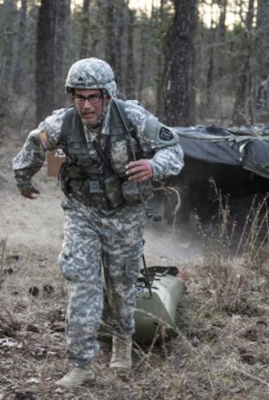 Sgt. Abraham Amavisca, a practical nursing noncommissioned officer with the 7305th Medical Training Support Battalion out of Sacramento, California pulls a basic rescue system loaded with a 40-pound mannequin through an obstacle course, March 8, 2016 during the Army Reserve Medical Command's 2016 Best Warrior competition at Fort Gordon, Ga. (U.S. Army photo by Sgt. 1st Class Brian Hamilton 108th Training Command- Initial Entry Training Public Affairs)