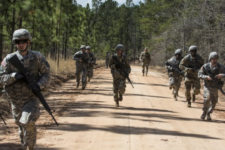 Soldiers competing for the title of Army Reserve Medical Command's 2016 Best Warrior react to indirect contact while on patrol during a situational training exercise March 9, 2016 as part of the competition at Fort Gordon, Ga. (U.S. Army photo by Sgt. 1st Class Brian Hamilton 108th Training Command- Initial Entry Training Public Affairs)