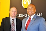 Michael Rector (left), DLA Joint Contingency Acquisition Support Office lead planner, and William Sanders, U.S. Central Command director of contracting support, learned about the vetting process for DLA Troop Support contracts in the CENTCOM area of responsibility March 16.