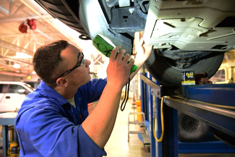 Airman 1st Class Michael Schulz, a 341st Logistics Readiness Squadron vehicle management flight mechanic, locates a vehicle's oil filter March 22, 2016, at Malmstrom Air Force Base, Mont. Schulz was one of two Airmen tasked with changing the oil of six vehicles which will be undergoing a 12-18 month testing period of a new bio-based synthetic oil. (U.S. Air Force photo/Airman 1st Class Magen M. Reeves)