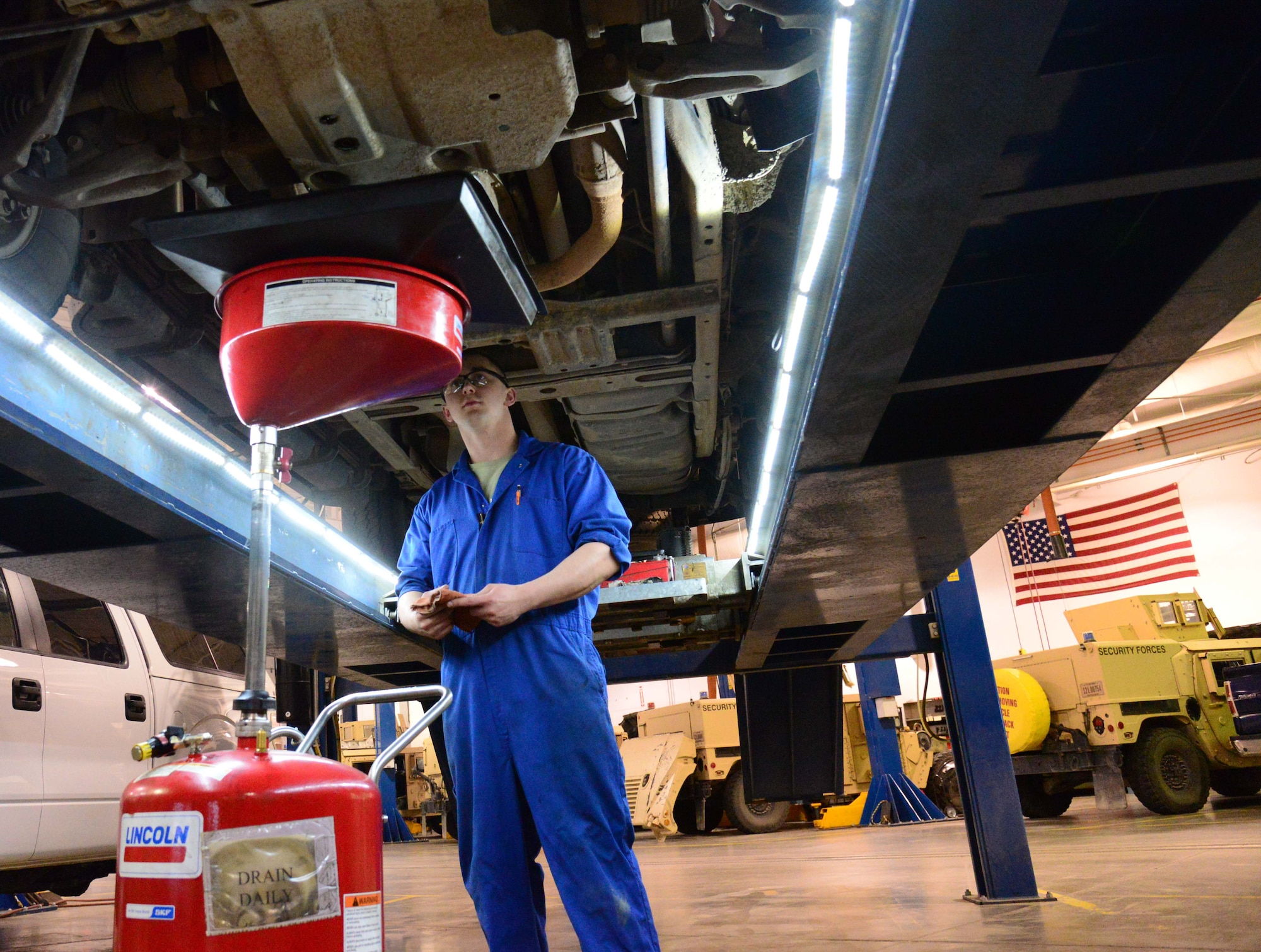 Airman 1st Class Michael Schulz, a 341st Logistics Readiness Squadron vehicle management flight mechanic, changes the oil of a government vehicle March 22, 2016, at Malmstrom Air Force Base, Mont. Schulz was one of two Airmen tasked with changing the oil of six vehicles which will be testing a new bio-based synthetic oil which could potentially help the Air Force's initiative to use more sustainable materials and be environmentally conscious. (U.S. Air Force photo/Airman 1st Class Magen M. Reeves)