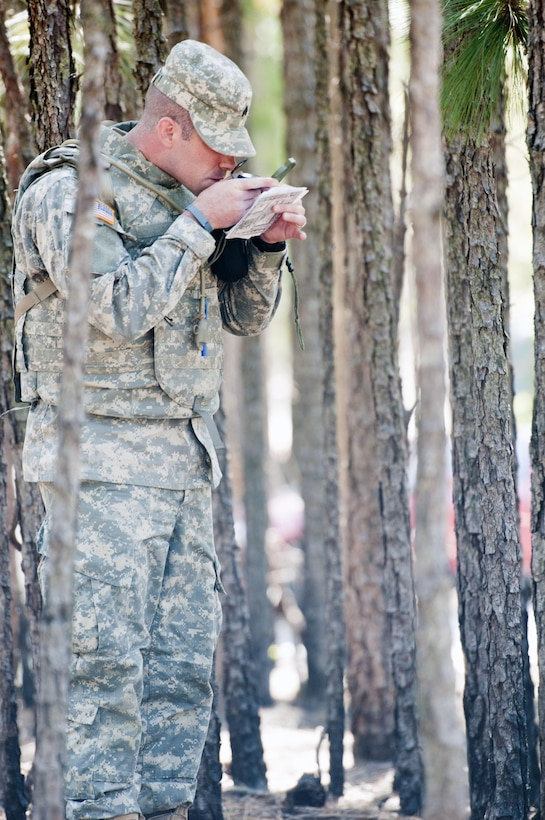 Sgt. David Brown, 98th Training Division (Initial Entry Training), checks his compass reading on the land navigation course at Fort Jackson, S.C., on March 21, during the Best Warrior competition for the 108th Training Command (IET). This year's Best Warrior competition will determine the top noncommissioned officer and junior enlisted Soldier who will represent the 108th Training Command (IET) in the Army Reserve Best Warrior competition later this year at Fort Bragg, N.C. (U.S. Army photo by Maj. Michelle Lunato/released)