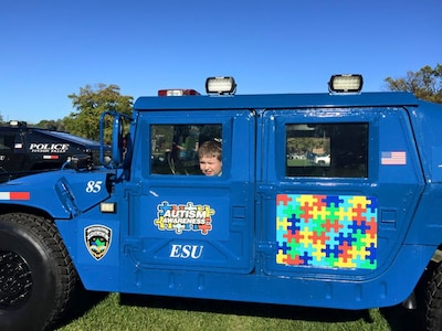 A child looks out from the Humvee the Tinton Falls (New Jersey) Police Department received through DoD's 1033 program. The department uses it to start conversations on autism. Photo by the Tinton Falls Police Department