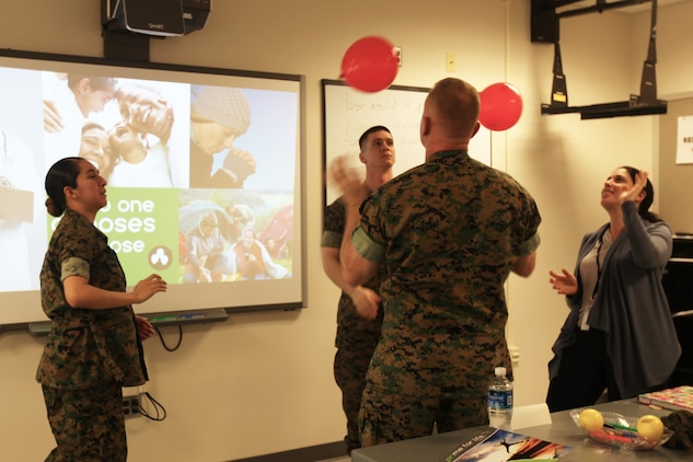 A group of Marines conduct an alcohol abuse prevention exercise using balloons during a Prime for