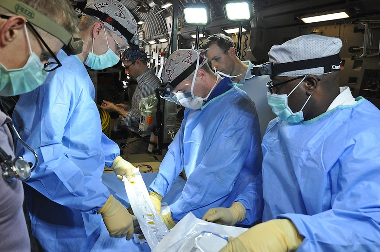 A medical crew from 59 Medical Wing at Joint Base San Antonio Lackland, practices medical procedures on a C-17 Globemaster III during a presidential support mission to Havana, Cuba.  The diplomatic mission was the first time a sitting U.S. president has visited the communist nation in 88 years.  (U.S. Air Force photo by Maj. Wayne Capps)