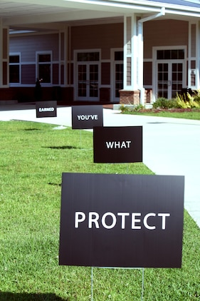 """Protect What You've Earned Campaign signs line a sidewalk during a """"Protect What. DWI Prevention Campaign educates service members on alcohol abuse"""