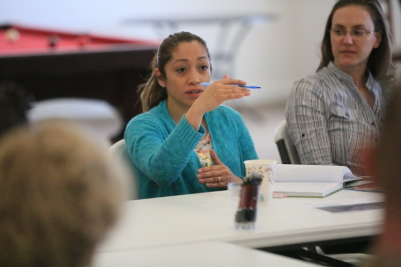 Soraya Feliciano, wife of Staff Sgt. Anthony Feliciano, intelligence analyst, Unmanned Aerial Vehicle Squadron 1, talks to members of the Resident Advisory Board during the  board's meeting at the Ocotillo Club House, March 17, 2016. (Official Marine Corps photo by Cpl. Julio McGraw/Released)