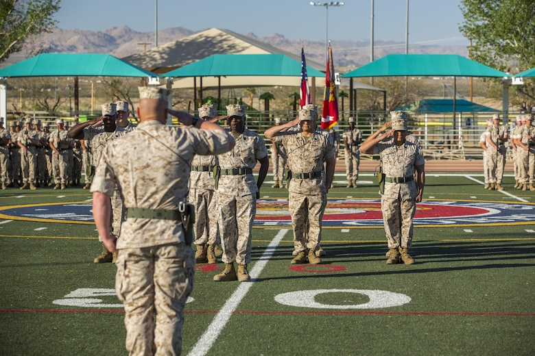 Lt. Col. Philip C. Laing, battalion commander, 3rd Light Armored Reconnaissance Battalion, salutes battalion staff during the battalion's relief and appointment ceremony at Felix Field March 18, 2016. During the ceremony, Sgt. Maj. Edward G. Zapata relinquished his position as battalion sergeant major of 3rd LAR to Sgt. Maj. Marcus A. Chestnut. (Official Marine Corps photo by Lance Cpl. Levi Schultz/Released)