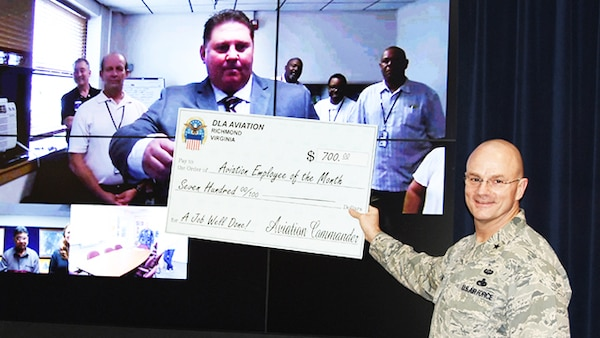 Defense Logistics Agency Aviation Naval Air Station at Jacksonville Florida employee David Scott was honored as the January 2016 Employee of the Month in a video teleconference ceremony at Defense Supply Center Richmond, Virginia, March 16, 2016. Scott works as an equipment specialist in the Customer Operations Directorate.