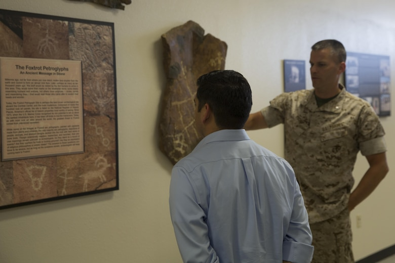 Lt. Col. Timothy Pochop, director, Natural Resources and Environmental Affairs, presents examples of petroglyphs that can be found aboard the Combat Center to Congressman Raul Ruiz during his visit to the installation, March 18, 2016. (Official Marine Corps photo by Cpl. Medina Ayala-Lo/Released)
