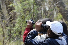 A close shot of children birdwatching by the Mississippi River.  (Photo by the U.S. Fish and Wildlife Service)