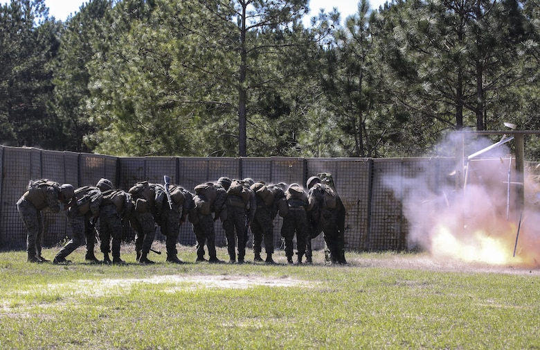 Marines with 2nd Combat Engineer Battalion breach a door during the assault breaching portion of the battalion's sapper squad competition at Camp Lejeune, N.C., March 22, 2016. The competition was organized to determine the most proficient squads in the battalion while simultaneously challenging squads in the execution of combat engineer-based tasks. (U.S. Marine Corps photo by Cpl. Paul S. Martinez/Released)