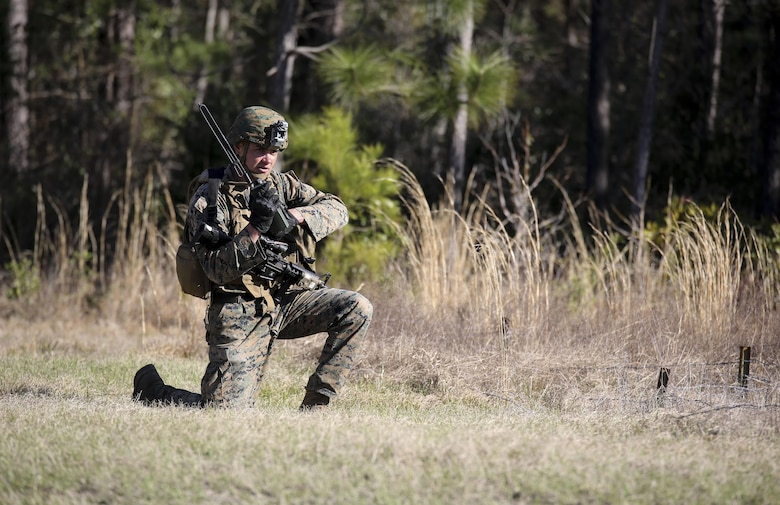 Cpl. Zachary Hannah, a combat engineer with 2nd Combat Engineer Battalion, communicates on a radio during the counter-improvised explosive device operations portion of the battalion's sapper squad competition at Camp Lejeune, N.C., March 22, 2016. The counter-IED portion of the competition put squads' observation skills to the test as they swept a lane of simulated IEDs. (U.S. Marine Corps photo by Cpl. Paul S. Martinez/Released)