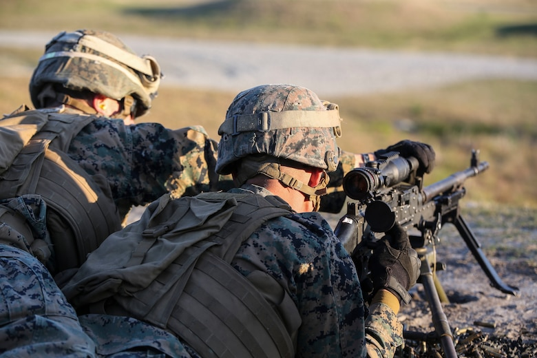 Marines with 2nd Combat Engineer Battalion conduct a barrel change on an M240B machine gun during the machine gun range portion of the battalion's sapper squad competition at Camp Lejeune, N.C., March 23, 2016. During this event, squads worked together to engage targets at ranges up to 800 meters. (U.S. Marine Corps photo by Cpl. Paul S. Martinez/Released)