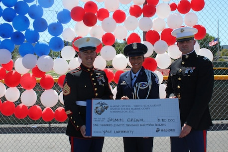 Staff Sgt. Joseph Colby, left, and Capt. Jeffrey Newman recognize Jasmin Grewal, center, a senior at Royal High School in Simi Valley, Calif., for accepting the selective U.S. Marine Corps Naval Reserve Officers Training Corps (NROTC) scholarship during a presentation at the high school, March 24, 2016. Grewal, won the scholarship based on her commitment in and out of the classroom, to the community, leadership abilities, and physical fitness, and plans to attend Yale University. (U.S. Marine Corps photo by Staff Sgt. Alicia R. Leaders/Released)