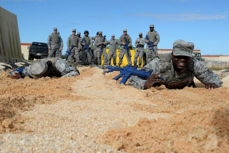 Airmen with the 36th Civil Engineer Squadron low crawl during a Prime Base Engineer Emergency Force exercise March 24, 2016, at Andersen Air Force Base, Guam. Airmen with the 36th CES practiced low crawls, high crawls and other tactical techniques during the Prime BEEF exercise to hone their skills and prepare for the future. (U.S. Air Force Photo/Airman 1st Class Alexa Ann Henderson)
