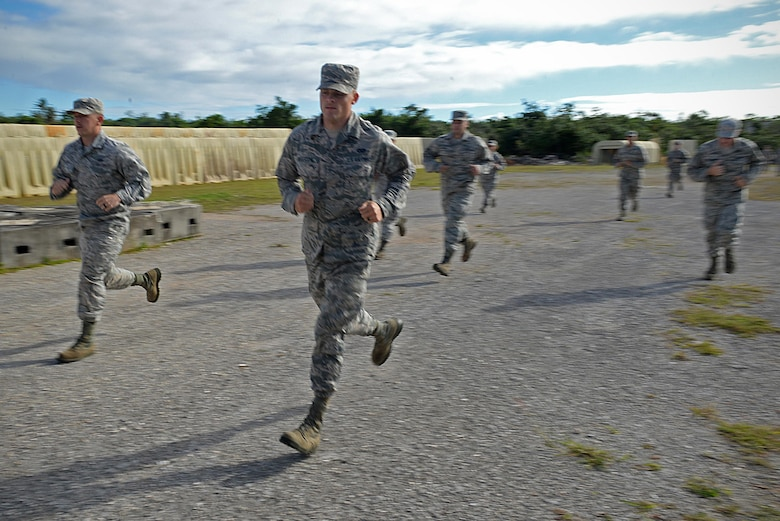 Airmen with the 36th Civil Engineer Squadron run during a Prime Base Engineer Emergency Force exercise March 24 at Andersen Air Force Base, Guam. Airmen with the 36th CES honed their skills in a simulated combat environment and night vision training as well as classroom lessons during the Prime BEEF exercise. (U.S. Air Force Photo/ Airman 1st Class Alexa Ann Henderson)