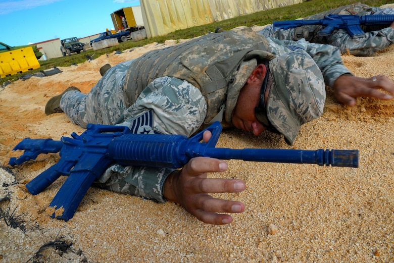 Tech. Sgt. Robert Alsup, 36th Civil Engineer Squadron  horizontal repair NCO in charge, practices a low crawl during a Prime Base Engineer Emergency Force exercise March 24, 2016, at Andersen Air Force Base, Guam. The main exercise objective was to develop and maintain a highly skilled, agile military combat support force capable of rapid response in support of worldwide contingency operations. (U.S. Air Force Photo/Airman 1st Class Alexa Ann Henderson)